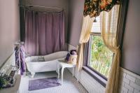 Easton Room - Clawfoot Tub/Shower Combo, window view of Victorian Garden