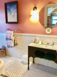 Oxford Room - Bathroom sink area and heated towel racks
