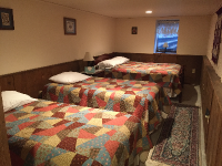 Cabin Family Suite sleeping area has 3 bids