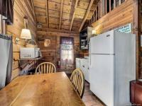 Full kitchen with fridge, oven, microwave, and coffee maker