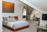 Crisfield Room - All natural wood platform bed, custom original artwork