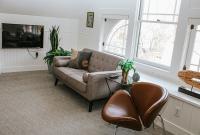 "Crisfield Room - Seatdng Area w/WiFi 43"" Smart TV and View of Neighborhood"