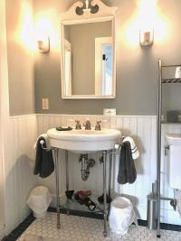 Crisfield Room - Bathroom Sink Area w/Vera Wang Towels and Hair Dryer