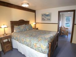 Queen bed in the Harbor Suite