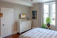 Closet, dresser, cable television, and room plants