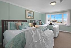 2-Queen Beds & Partial Ocean View