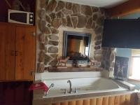 Jetted tub under Fireplace