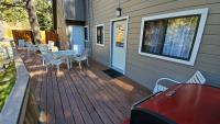 Deck with gas barbecue, tables and chairs.