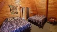 2 queen beds with Cable TV, electric wall heater and ceiling fan.