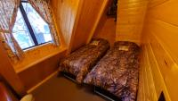 Small bedroom in center of chalet with 2 single beds & electric wall heater.
