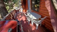 Deck with gas barbecue, table and chairs.