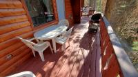 Deck in back (adjoins deck with #16) with gas barbecue, table & chairs.
