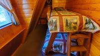 Small bedroom with bunks, twin and single.