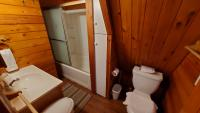 Bathroom is beside the kitchen at the entrance of chalet.