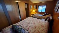 Bedroom with a queen bed and a twin bed.