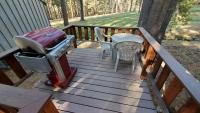 Deck with gas barbecue, table & chairs.