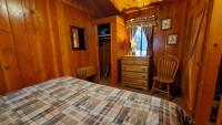 Bedroom with king bed. The other bedroom has 2 single beds.