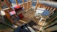 Deck with gas barbecue year round, table & chairs for summer.