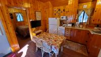 Fully furnished kitchen, showing dinette, Cable TV, Blueray & WiFi.