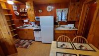 Fully furnished kitchen, gas range, refrig/freezer, microwave, toaster, etc.