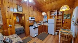 A look in at the kitchen and dinette; king bed in bedroom.