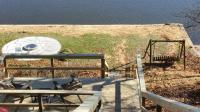 Waterfront with firepit, kayak, seawall & swing