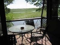 Screen porch overlooking river and marsh