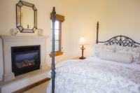 Castellina Guest Suite, View of Fireplace and Bed, The Canyon Villa, Paso Robles