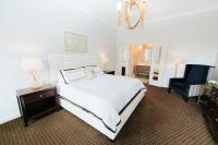 Spacious King Bedroom with comfortable armchair and writing desk